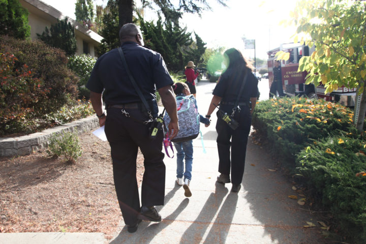 Lillia Bartlow points to the fire engine arriving at her house to escort her to school on Tuesday Aug. 30. Photo: Kelly Sullivan