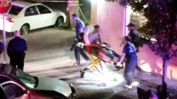 The 17-year old shot in the face Friday night is taken to the hospital. Photo Chris Greacen