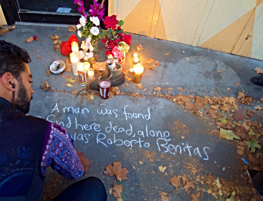 A group of people held a memorial service Friday for a homeless man who died on the street. Photo: Ted Friedman