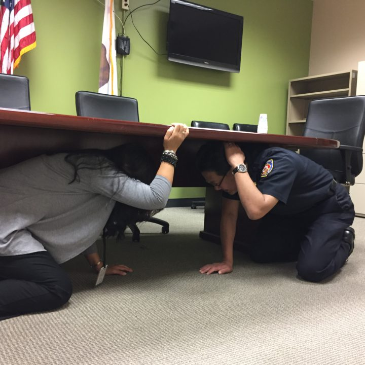 Fire Chief Gil Dong and a member of his staff practice for Great ShakeOut Day.