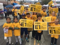 Berkeley students carry Yes on E1 signs during the Solano Stroll. Photo: Yes on E1 campaign