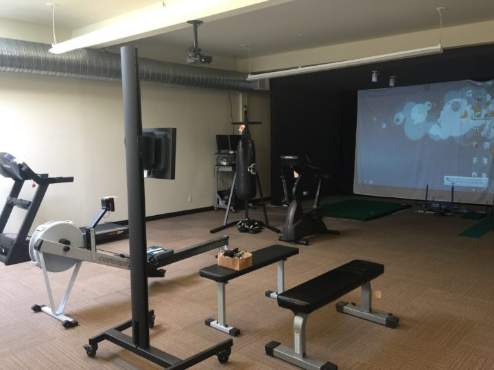 The contents of John Fox's gym, including his golf simulator and work out machines, will be auctioned on Saturday. Photo: Frances Dinkelspiel