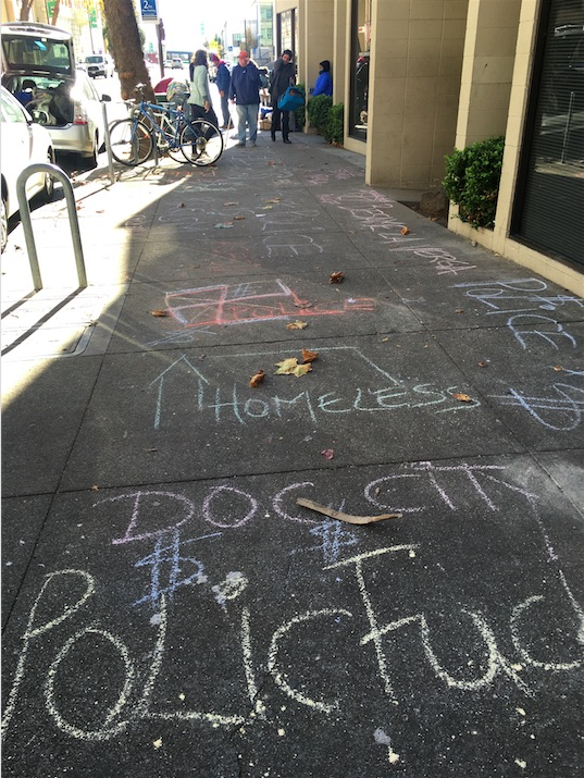 Fuck the Police and other messages written with chalk on the Milvia sidewalk near where a group of homeless people had congregated following a raid on a nearby camp — on Dec. 2, 2016. Photo: Tracey Taylor