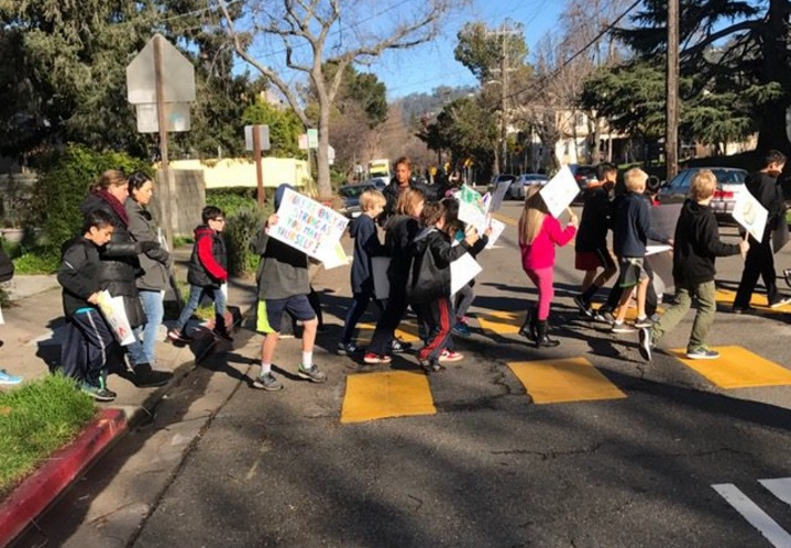 Emerson Elementary School students march through the Elmwood neighborhood on Friday Jan. 13 for their annual MLK Day march. Photo: Wendy Cohen