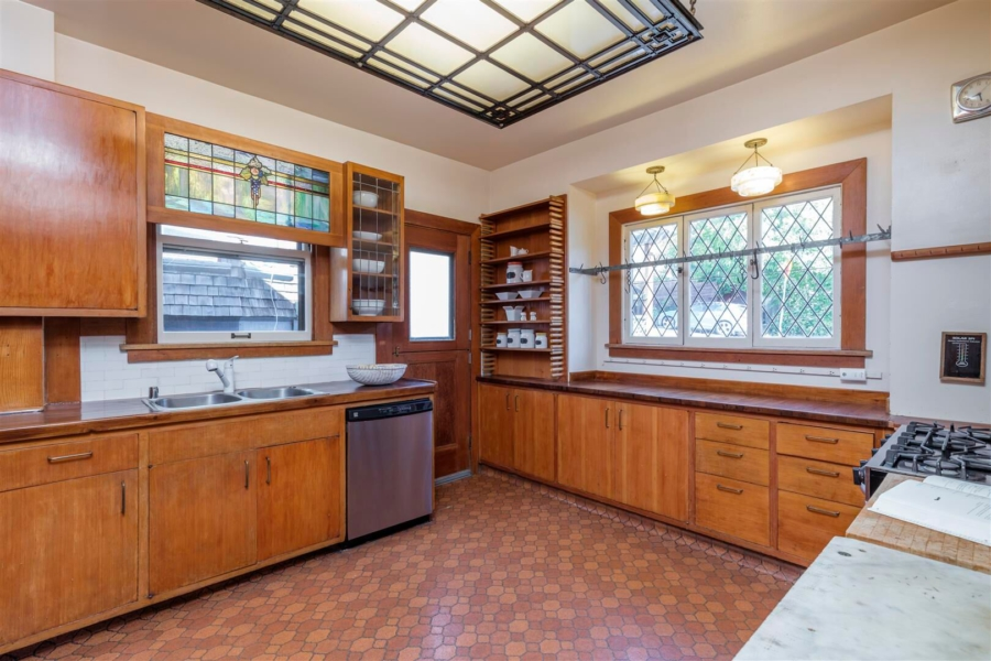 1970s kitchen, with stained glass over the sink. Photo courtesy of Christian Kluggman Photography, The Ratoosh Group.