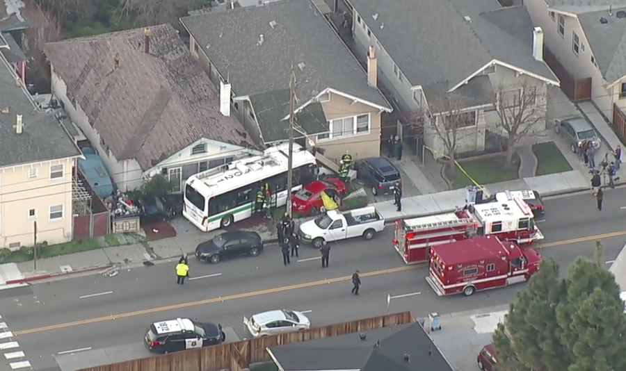 Woman, 27, dies after AC Transit bus and car collide, crash into