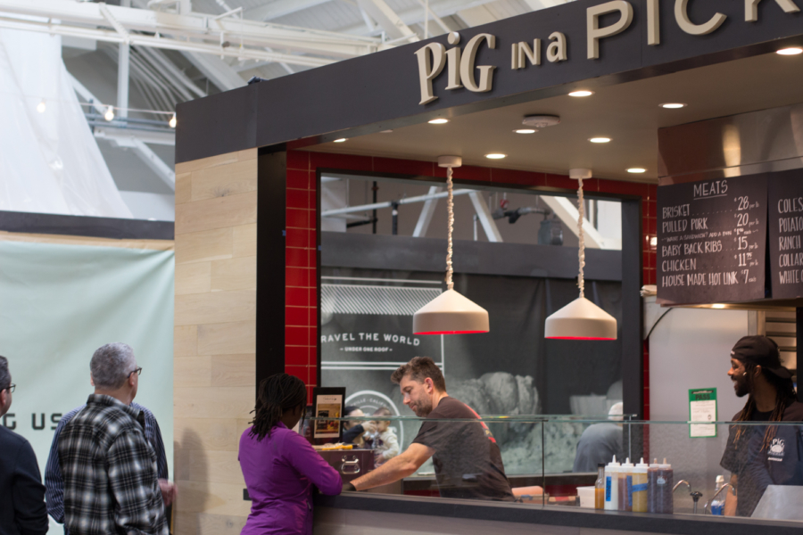 People standing in line at the Pig in a Pickle kiosk at Public Market Emeryville.