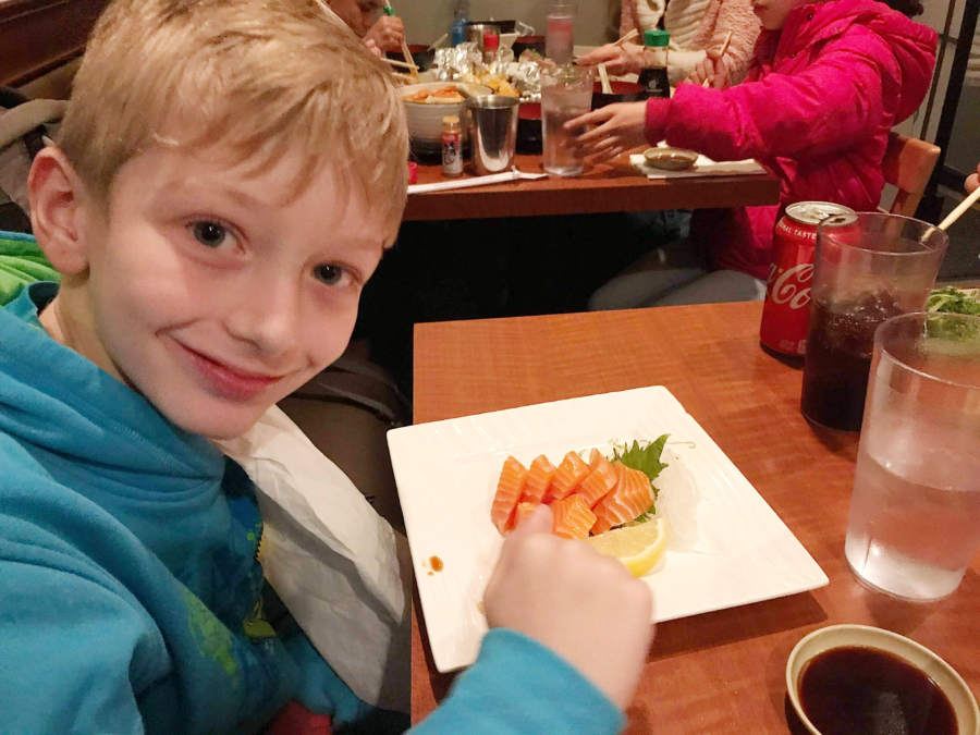 A young boy points to a plate of salmon sashimi at Shimizu in Oakland.