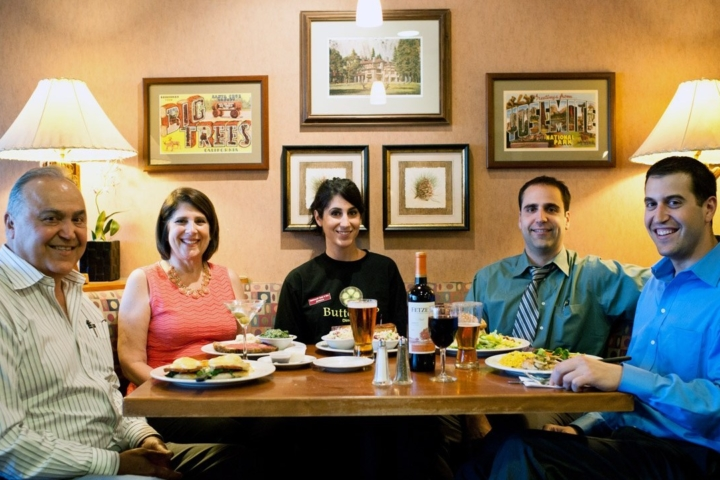 The Shahvar family, owners of the Buttercup Diner sit around a table at the restaurant in Walnut Creek.