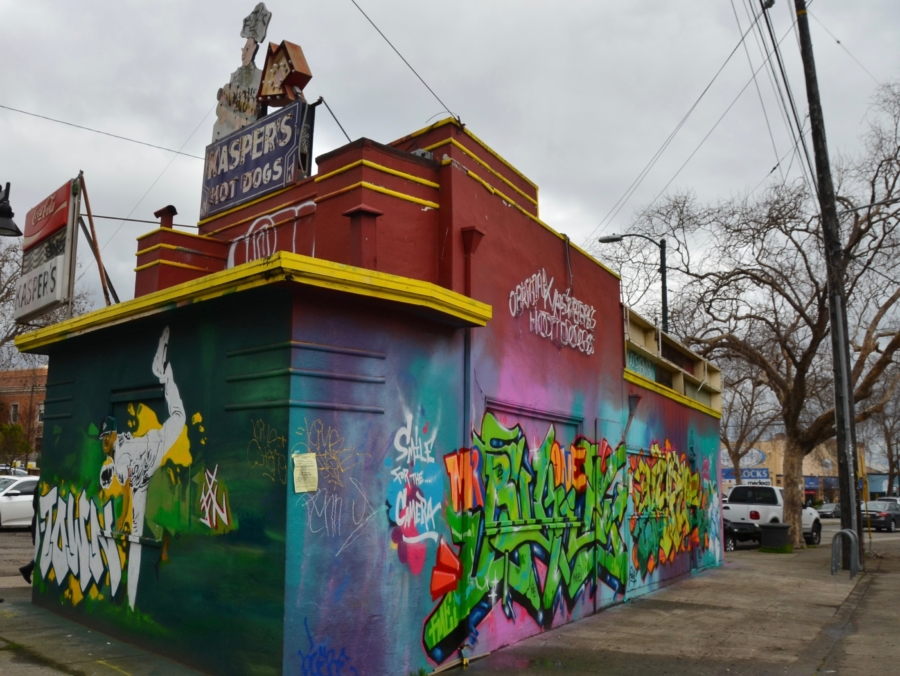 The Kasper's Hot Dogs building in Temescal covered with grafitti and street art.