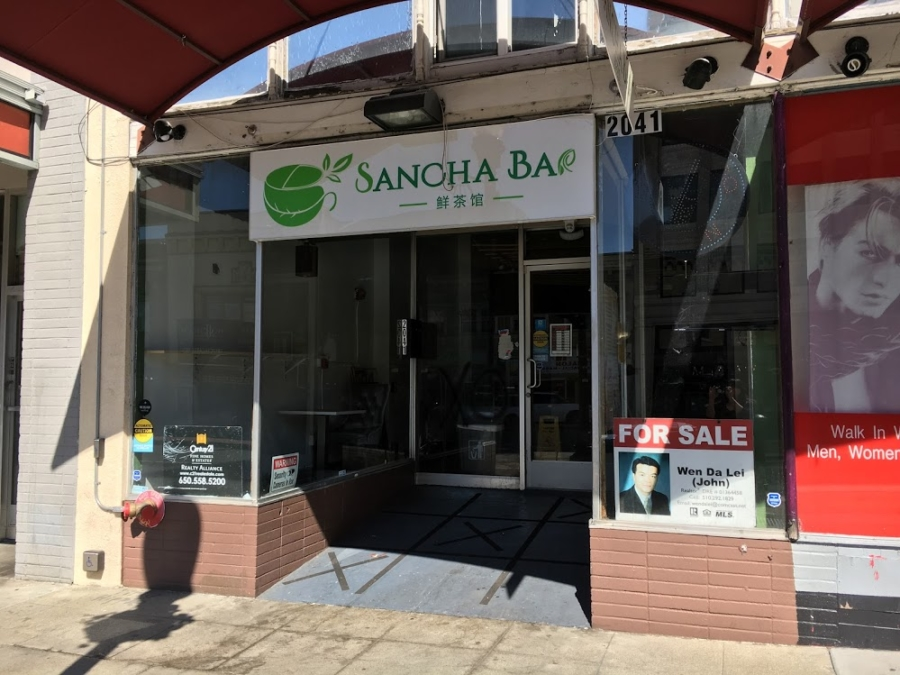 Closed for business, Sancha Bar in downtown Berkeley displays a 'for sale' sign in the window.
