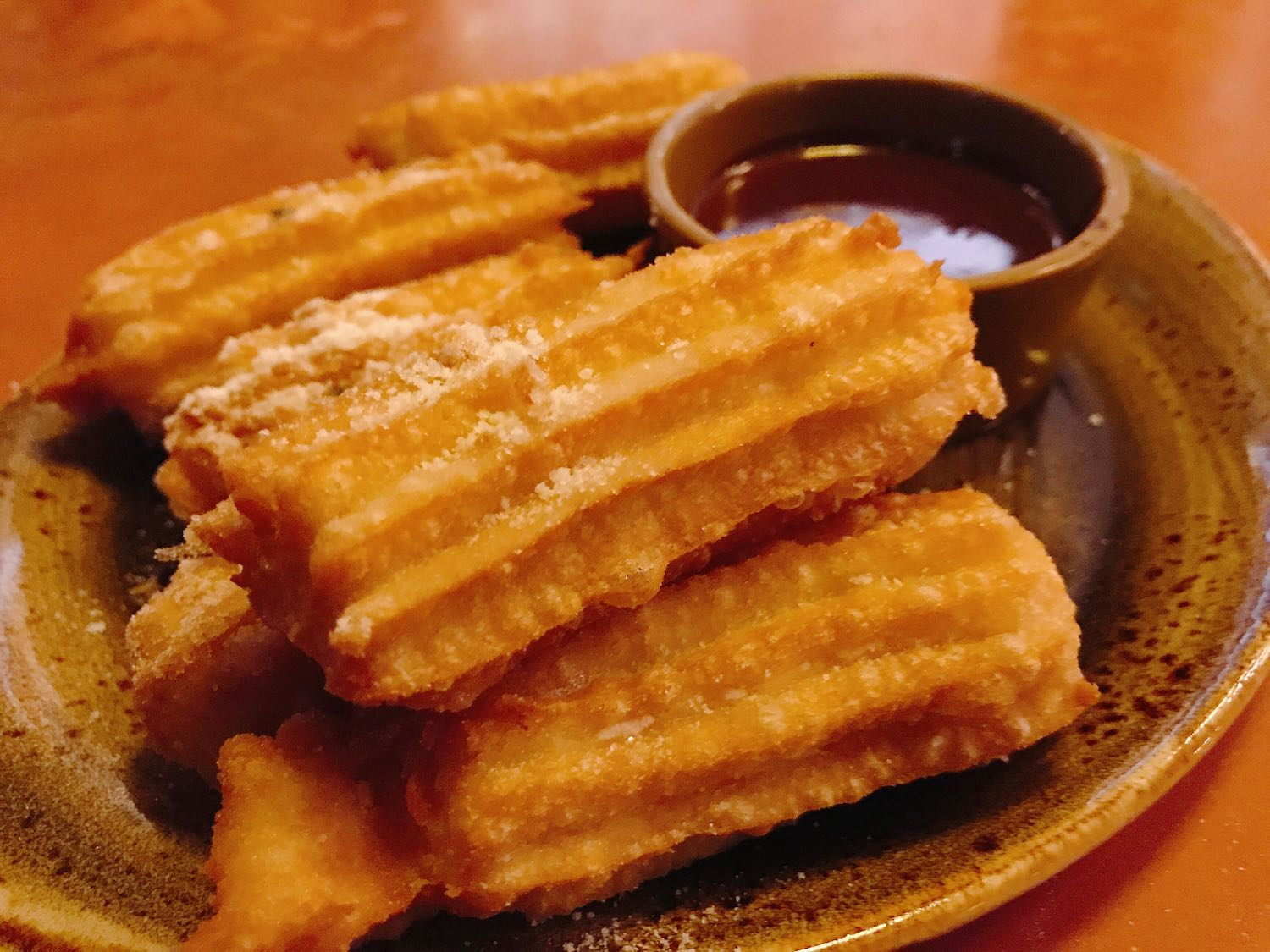 A plate of churros with a chocolate dipping sauce from Shakewell in Oakland.
