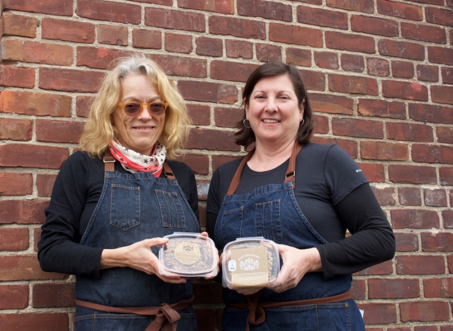 Birgitta Durell (left) and Dianna Dar, co-owners of Cult Crackers, stand with packages of their Swedish seed crackers at The Berkeley Kitchens.
