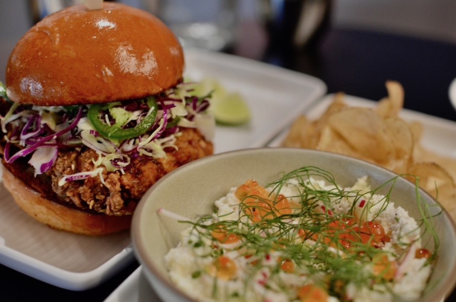 A fried chicken sandwich and a potato chip starter served with whipped ricotta topped with salmon roe, fennel and radish, will likely always be on the food menu at Here's How.