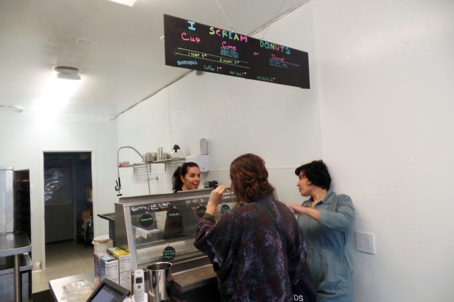 I Scream Donuts' owner Katie Wages helps customers at her ice cream-filled donut shop in Oakland's Temescal neighborhood.