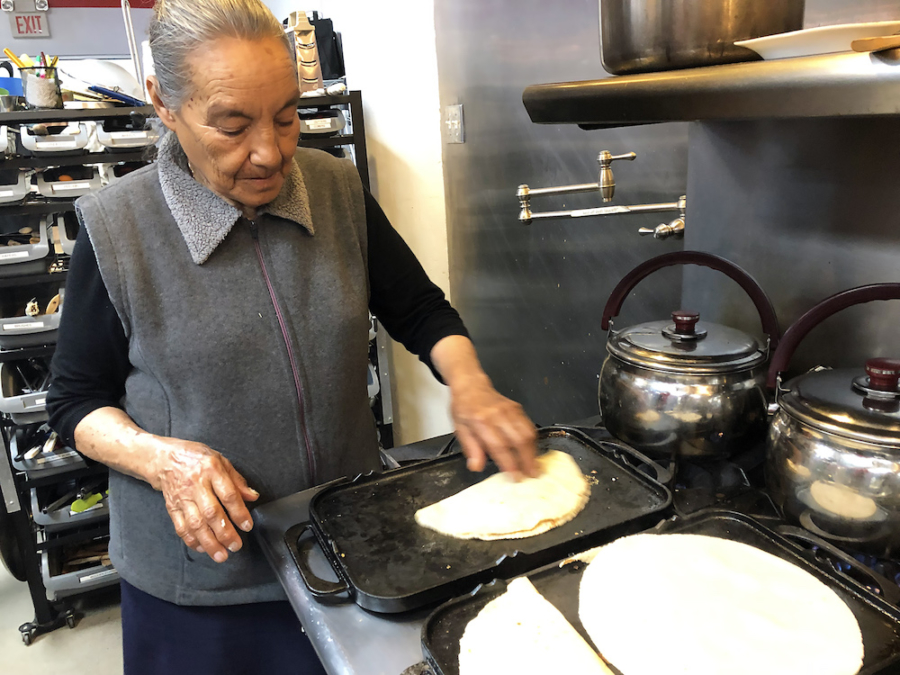 "The mother of chef Cecilia Chiarez prepared quesadillas at ""Nourishing Roots"" at the ITK Culinary kitchens in Emeryville."