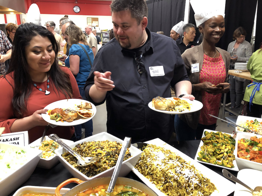 "Guests enjoy the multi-cultural spread at ""Nourishing Roots,"" a culinary event at ITK Culinary in Emeryville."