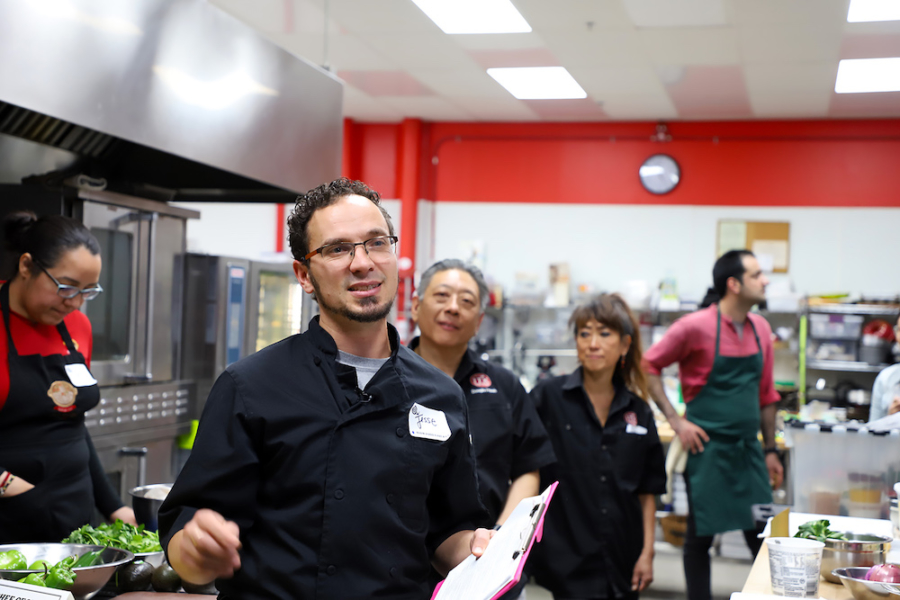 "Jesse Bloom of Sacred Kitchens, front, and Doug Eng of ITK Culinary, seen behind him, at the ""Nourishing Roots"" event at ITK Culinary in Emeryvile on March 31."