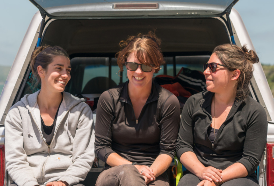 Salt Point Seaweed founders Catherine O'Hare, Avery Resor and Tessa Emmer sit in the open trunk of a car.