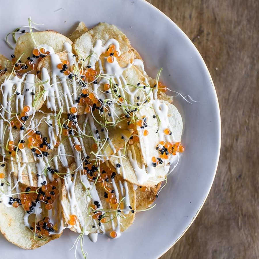 Truffle potato chips, with crema, caviar and micro herbs, at Town Square Eats inside of Crooked City Taphouse in Jack London Square.