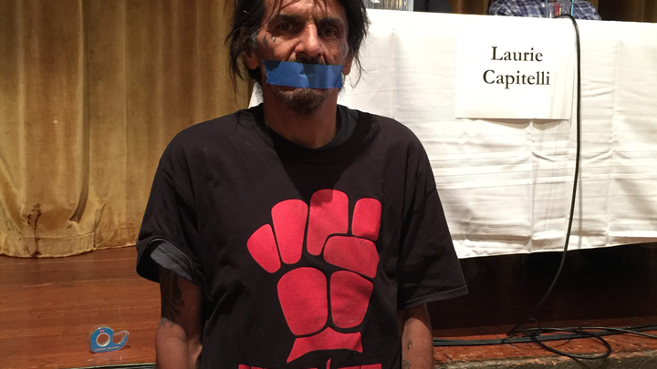 Zachary RunningWolf put tape over his mouth in 2016 to protest the fact that he was not invited to speak at a mayoral forum.