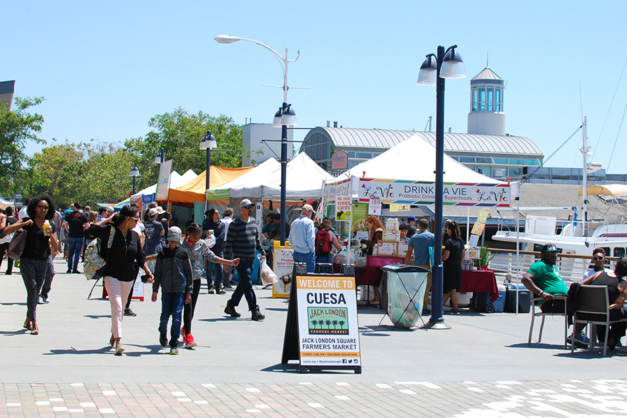Attendees visit booths at CUESA's Jack London Square Farmers Market.