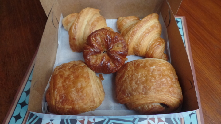 A pastry box filled with French pastries from Pâtisserie Rotha in Albany.