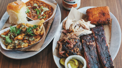 Plates of barbecued meats and sides from 4505 Burgers & BBQ in Oakland.