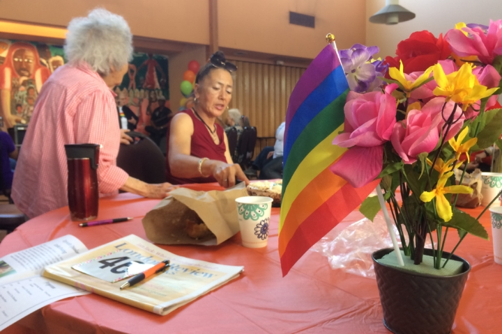 Seniors at table for gay day pride event
