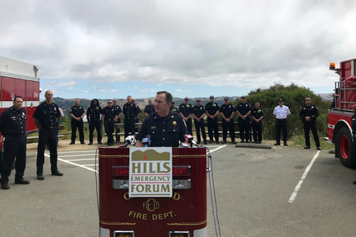 Berkeley Fire Chief David Brannigan speaks at a press conference at Inspiration Point
