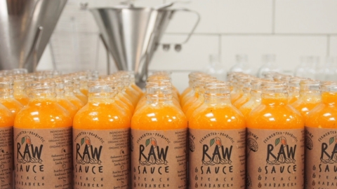Bottles of Peach Habanero fermented hot sauce by Oakland-based Raw Sauce.