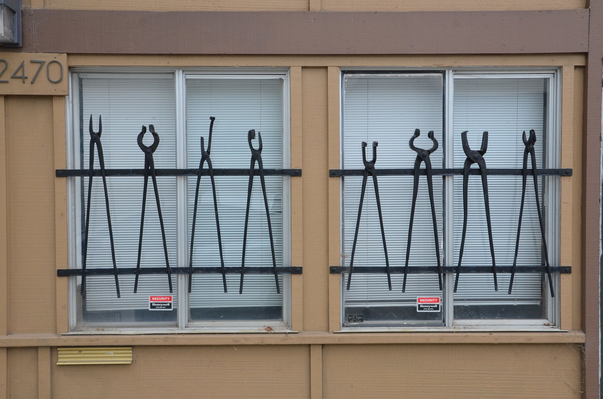 pair of windows with iron tongs displayed