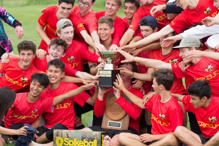 Berkeley High Coup players all reach to touch the trophy acquired at the Ultimate Frisbee Nationals