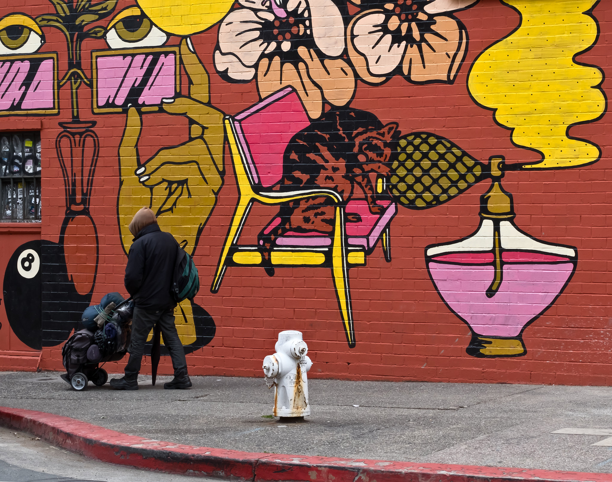 Person walking in front of a mural on Telegraph Avenue in Berkeley