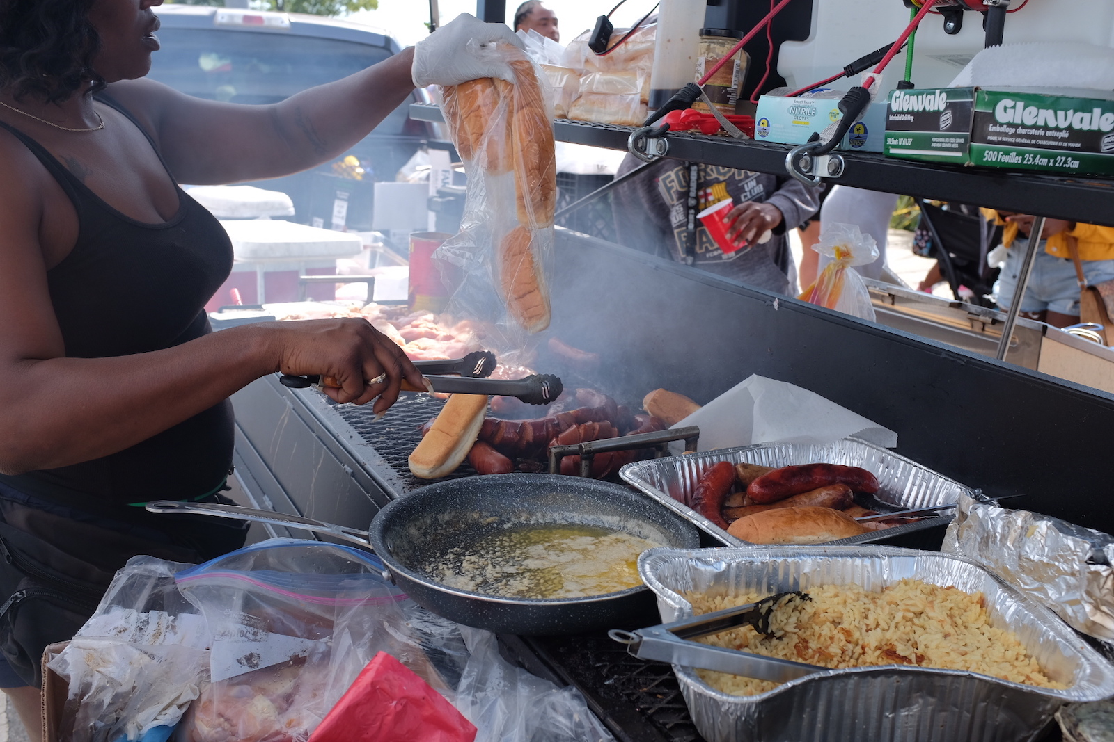 An attendee with a full grill set-up at the second annual BBQ'n While Black at Lake Merritt.