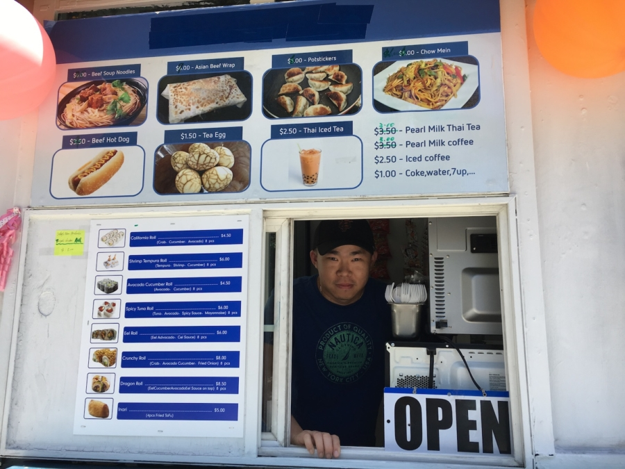Owner John Xie at the ordering window of Bento Chef, a small to-go kiosk in downtown Berkeley.