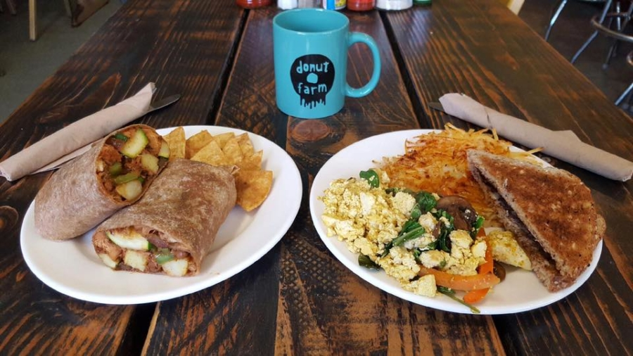 Plates of vegan fare from Donut Farm in North Oakland.