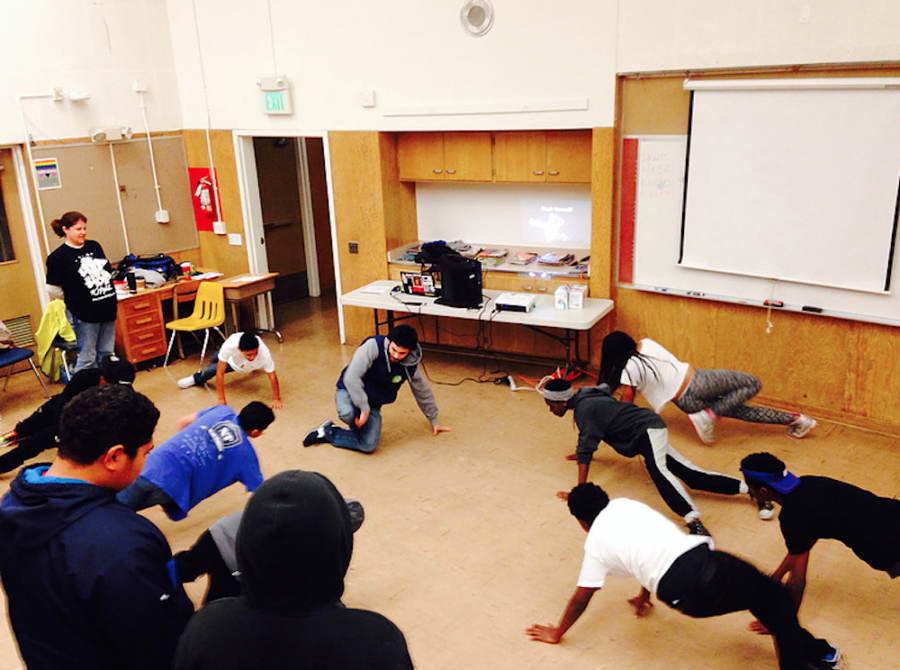 Kids learn to breakdance in a Hip Hop For Change Workshop