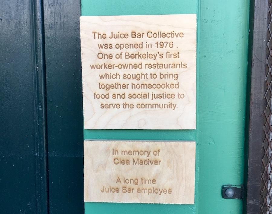A plaque, paying homage to Juice Bar Collective and longtime collective member Clea McIver, hangs at Fava. Photo: Sarah Han