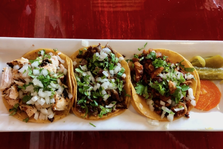 A taco plate with grilled chicken, steak and chorizo at Porque No? Tacos, a permanent pop-up inside Pucquio in Rockridge.