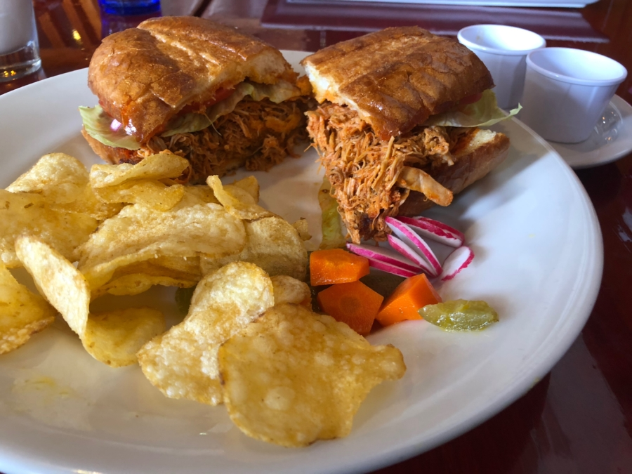 A plate with Torta Jalisco and house-fried potato chips from Porque No? Tacos in Oakland.