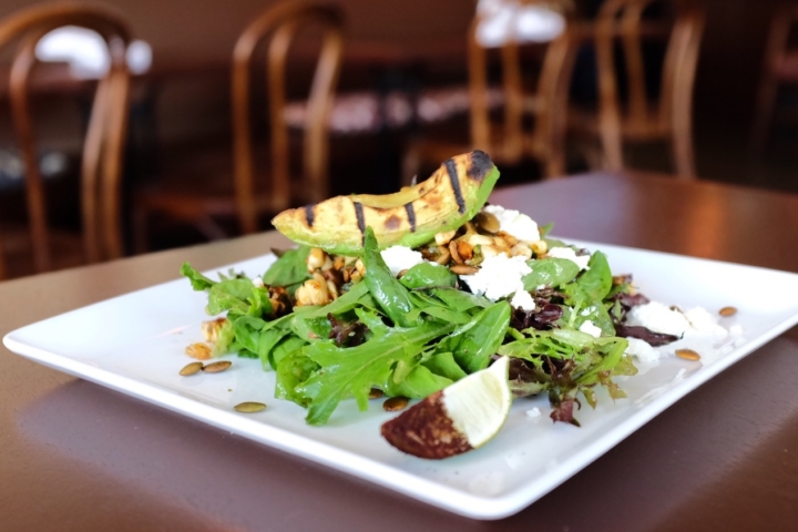 The charred corn salad at Golden Squirrel costs $15, or $14 if without avocado.
