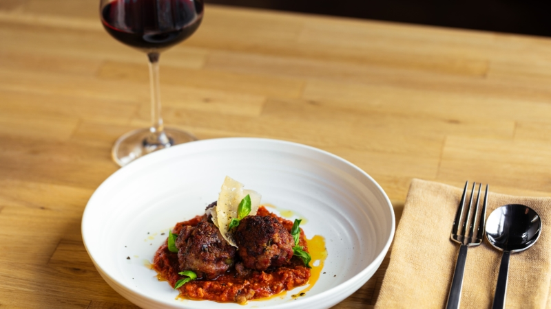 Pan-fried meatballs doused in sugo are a constant on Mama's rotating menu.