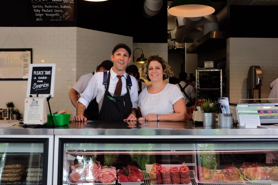 Co-owners Aaron and Monica Rocchino stand behind the counter at the Local Butcher Shop in Berkeley. P