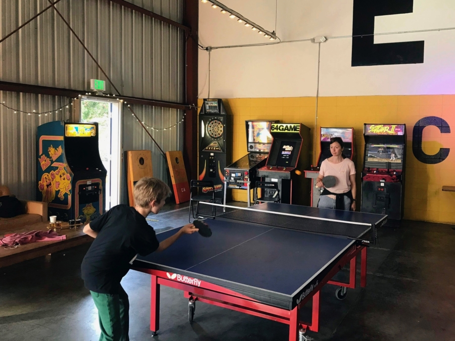 A mother and son play pingpong at East Brother Beer Company in Richmond.