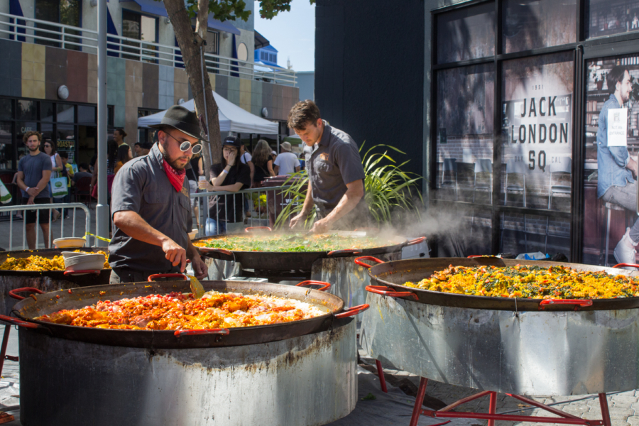Large pans of paella made on site by Gerard's Paella.