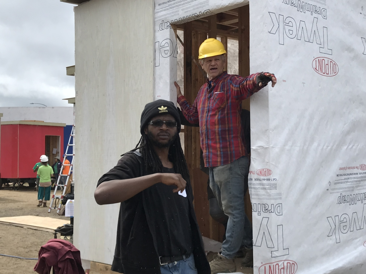 volunteers building a tiny home