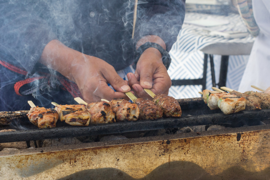 Grilling yakitori skewers on a binchotan grill. Photo: Benjamin Seto