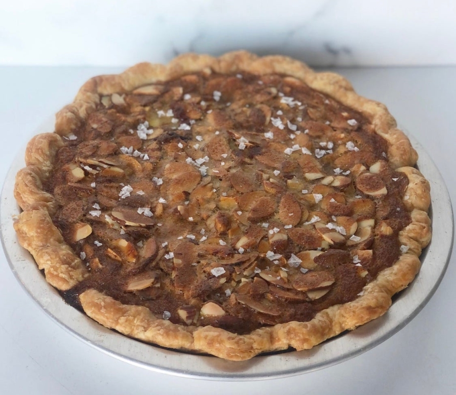 The Natty Cakes Thanksgiving Pie features a chocolate custard topped with almond toffee and sprinkled with flakey salt.
