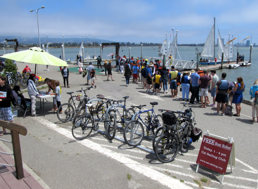 people hanging out by sailboats in the Berkeley Marina